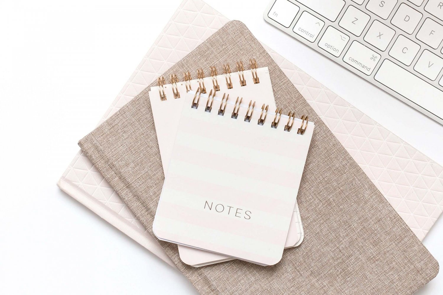 Pile of Notebooks - Getting Organised - Why You Should Hire a Virtual Assistant by Wildflower in Holmfirth