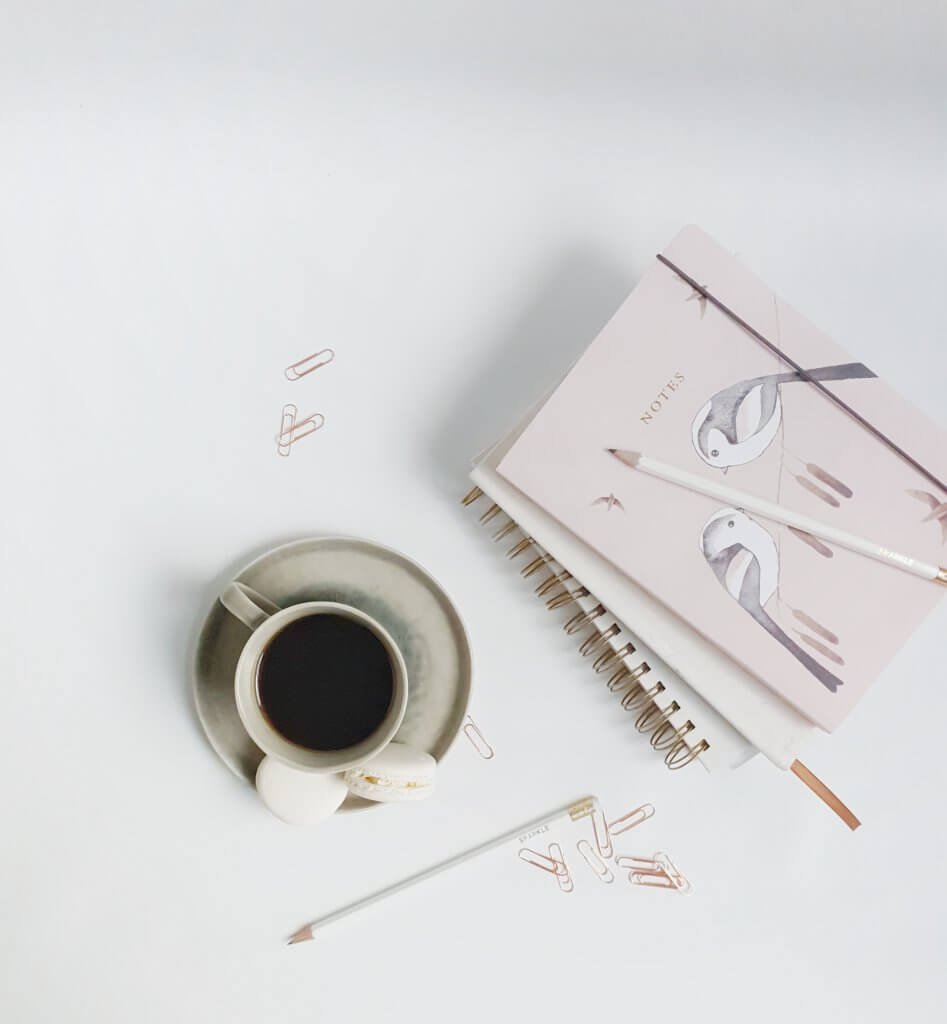Pink Notebooks and Black Coffee Photo by Wildflower Virtual Assistant Services
