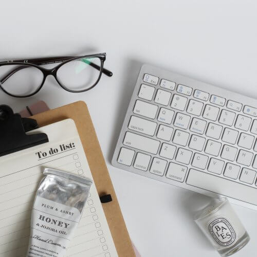 Monochrome Office Flat Lay with Glasses, To Do List and Diptyque Candle