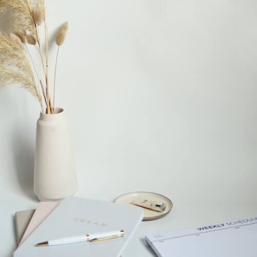 Home office scene with pale neutral stationery - Wildflower Pinterest Manager UK