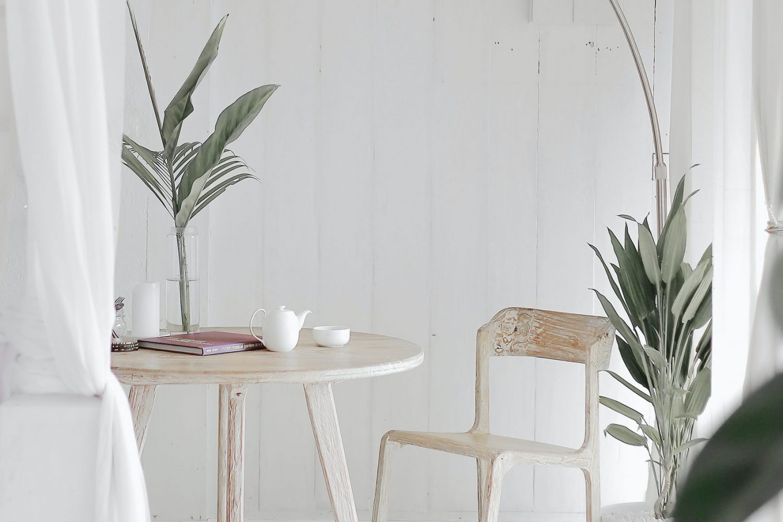 Calm scandi-style desk scene with greenery and whitewashed wood desk - Wildflower Pinterest Management