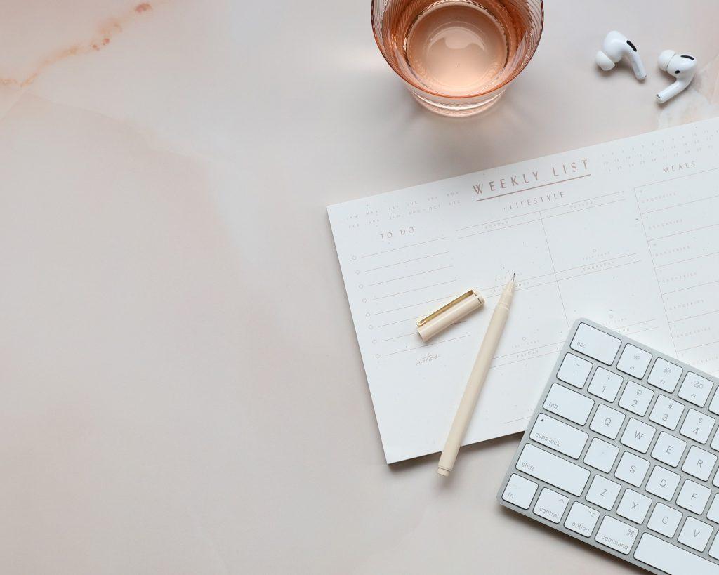 "Pink desk scene from blog post ""Pinterest Marketing Tips"" by Wildflower Pinterest Management"